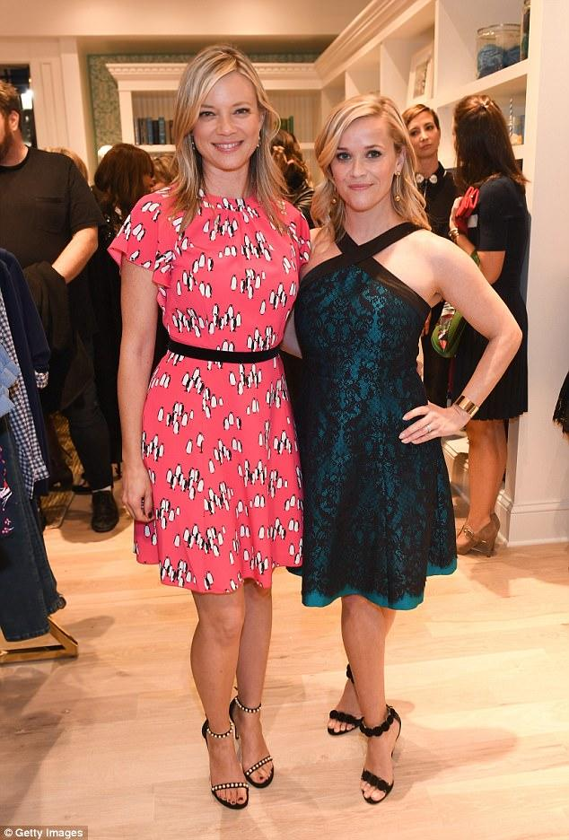 Fresh-faced Reese Witherspoon, 41, looks sensational in emerald and black lace dress!