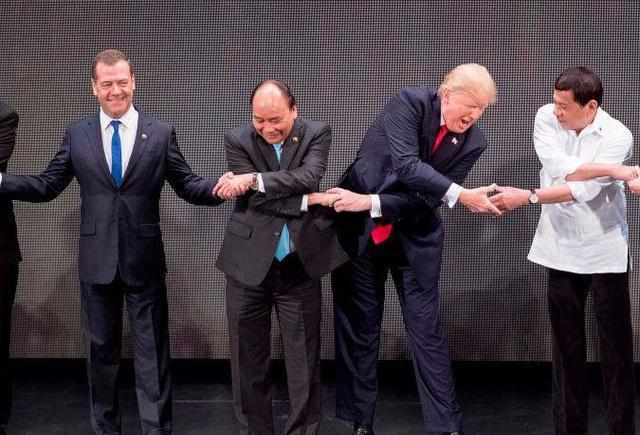 While we were all laughing at Trump's awkward handshake, you missed this guy in the corner