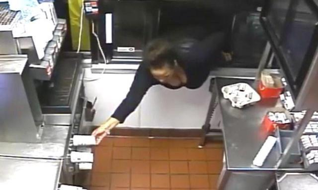 Thirsty thief pours herself drink by leaning through McDonald's window before stealing food and cash