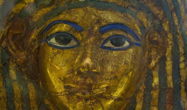 Ancient Egyptian mummy wearing golden mask uncovered near Cairo