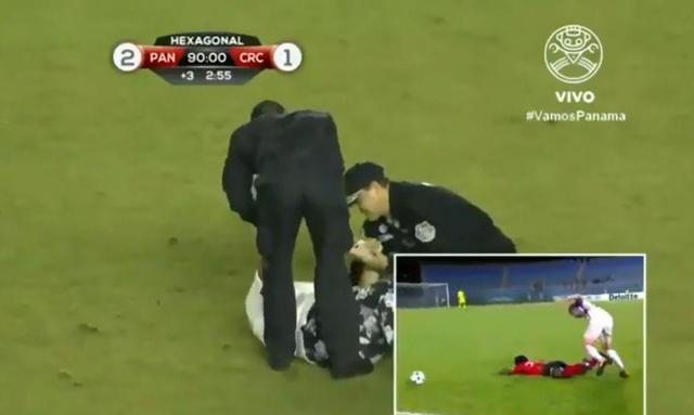 Football mad gran runs onto pitch and pretends to FAINT in attempt to assure her country qualifies for World Cup