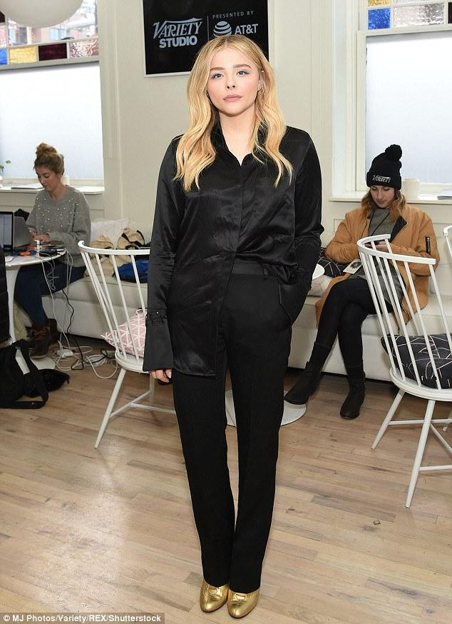Black Clad Chloe Grace Moretz Rocks Gold Booties And Hair Extensions
