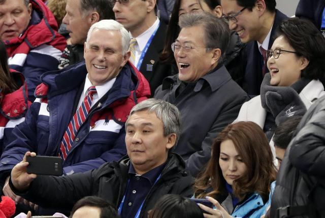 The Latest: Pence, Moon speak while watching speedskating