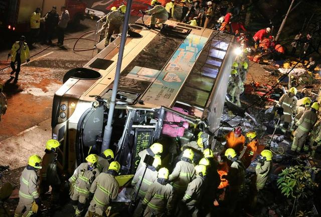 At least 18 killed, 50 injured as bus topples over in Hong Kong