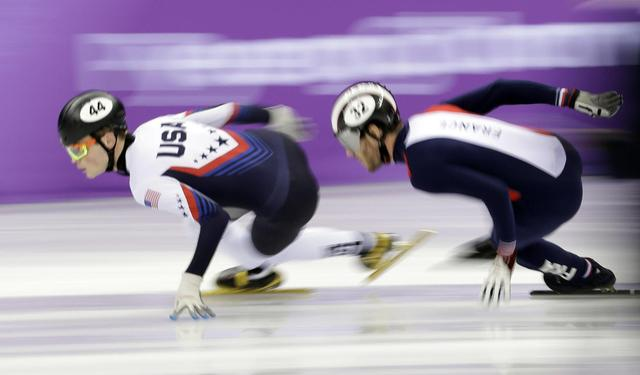 The Latest: Pence and Moon chat while watching speedskaters