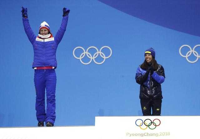The Latest: Pence cheers on US speedskaters at Olympics