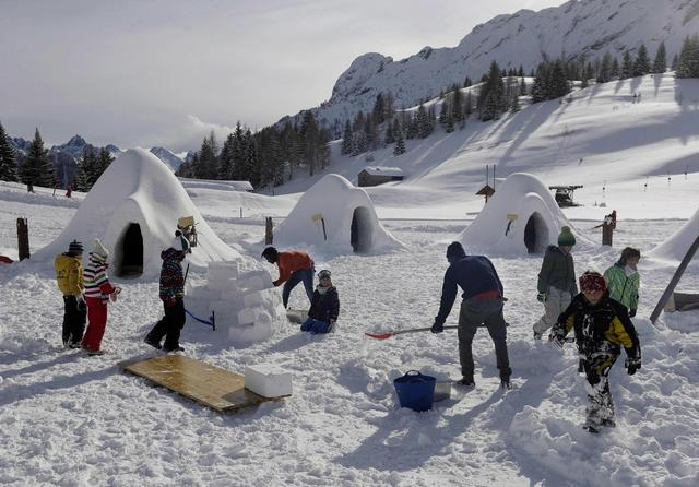 Igloos warm hearts in old ski town where migrants fill hotel