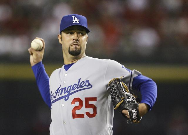 The Latest: Ex-All Star pitcher Esteban Loaiza arrested