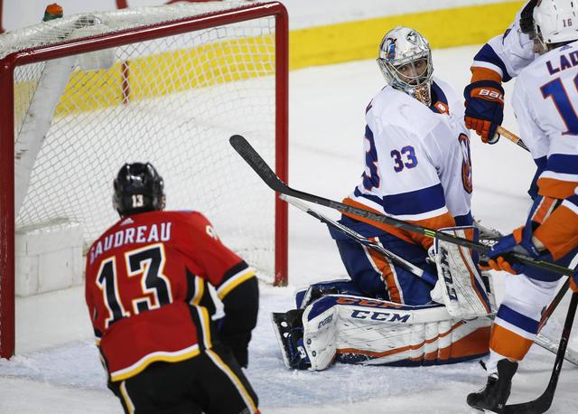 Gibson makes 50 saves, Islanders beat Flames 5-2 to end skid