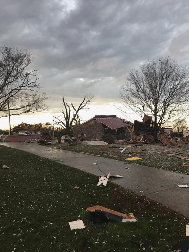 The Latest: Weather service assessing storm damage