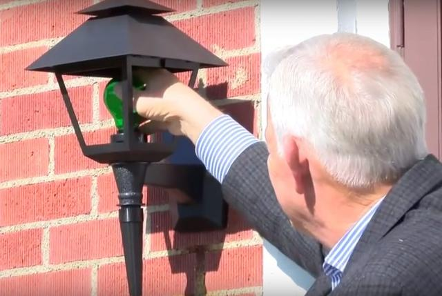 More Homeowners Are Putting Green Lights Outside Their Houses To