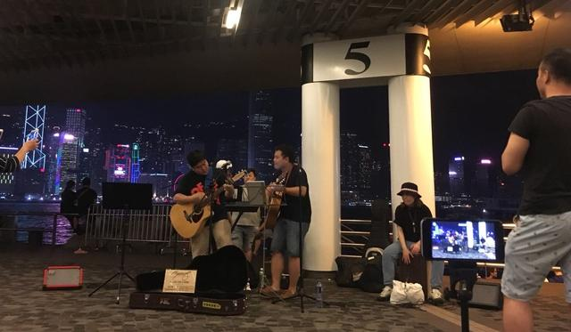 Why some Hong Kong buskers prefer playing in Tsim Sha Tsui over Mong Kok