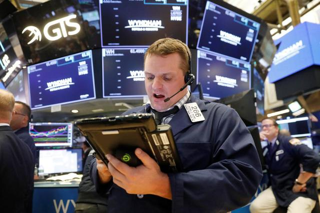 Media, telecom shares lift futures; Fed awaited