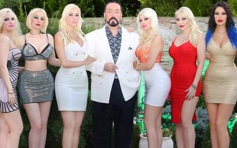 Turkish televangelist who surrounded himself with scantily-clad women detained on fraud and sex charges