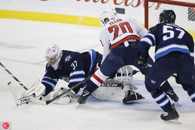 Capitals Jets Hockey Winnipeg Jets goaltender Connor Hellebuyck (37) jumps  on a loose rebound ... 48d723089