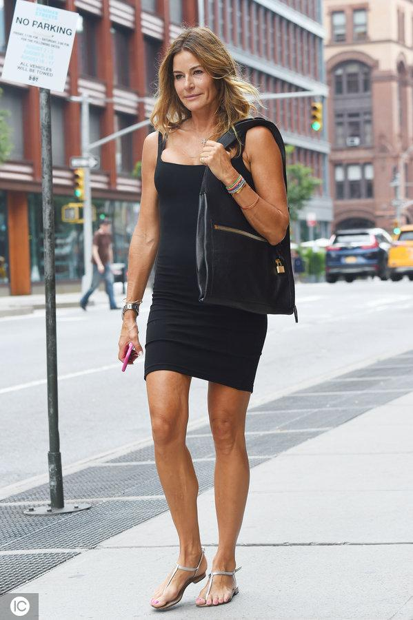 Kelly Bensimon shows off her toned legs in a black mini dress