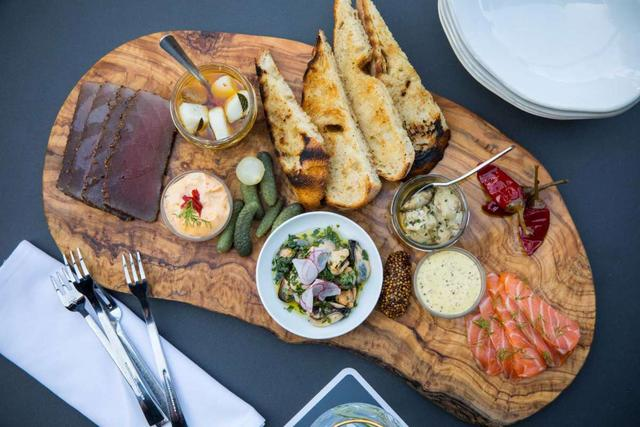 At Houston restaurants, meat and cheese boards are moving...