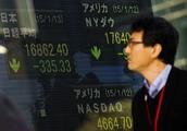 Asian Equities Mixed Amid Turkish Lira Crisis; China Data in Focus