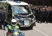 Top Hong Kong officials pay respects at funeral of police officer killed on duty