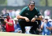 Phil Mickelson caught up in bizarre controversy after deliberately stopping his ball rolling off gre
