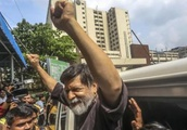Bangladesh accused of torturing jailed photographer, protest leaders