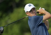 Rain Halts Second Round of PGA Championship, but Gary Woodland Still Leads as Record Low Scores Cont