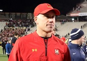 Maryland coach DJ Durkin placed on administrative leave after a player's death and a report on the t