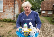 Boris Johnson emerges from his home with cups of tea for journalists as he avoids questions on burka