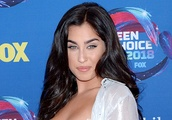 Lauren Jauregui Shows Toned Abs in White Bra Top & Reflective Pants at the Teen Choice Awards