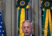 US defense chief hears shots during visit to Rio de Janeiro