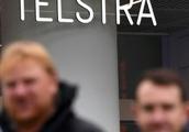 Australia telecom giant Telstra flags tough times as profit slides
