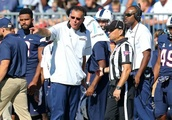 College football UConn UCF line odds spread and pick