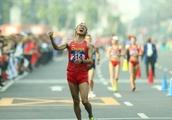 Wang Kaihua wins gold medal of men's 20km walk of athletics
