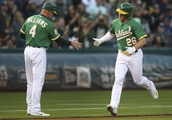 A's top Mariners, cut Astros' lead in AL West to 1½ games