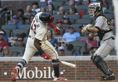 Acuna uses power, speed to help Braves pad division lead