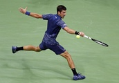 The Latest: Djokovic beats Millman to reach US Open semis
