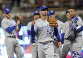 Lopez 3 outs shy of perfect game as Royals beat Twins 4-1