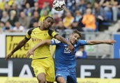 Pulisic again rescues 10-man Dortmund from first defeat