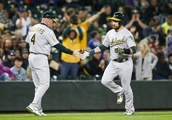 A's clinch playoff berth, then mash Mariners