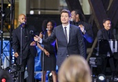 *NO MAIL ONLINE* Canadian Crooner, Michael Buble, performs live in the pouring rain for his Australi