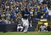 After blowing lead, Brewers top Rockies in NLDS opener
