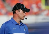 Air Force football coach sends QB into game with apparent concussion