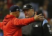 Red Sox catcher Christian Vazquez plunks umpire Joe West with errant throw