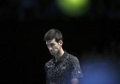 Djokovic cruises past Isner in ATP Finals opener