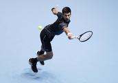 Djokovic overcomes illness to progress at ATP Finals
