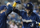 Brewers survive late scare to take 2-1 lead on Dodgers