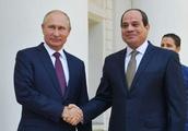 The Latest: Putin says US sanctions erode trust in dollar