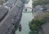 Tourists visit historical water town Wuzhen in E China