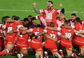 Tongans devise novel way to keep excitable crowd calm: Methodist hymns