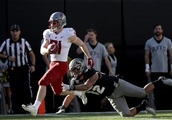 Washington State football overpowers depleted Colorado for 9th win